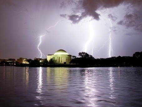 Three cloud-to-ground lightning bolts strike behind the Jefferson Memorial at 8:53 PM Wednesday night. Strong breezes at the time created ripples across the surface of the Tidal Basin which were illuminated by the lightning.  Photo Kevin Ambrose (via Jefferson's lightning! - Capital Weather Gang - The Washington Post)