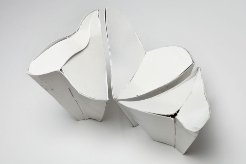 LOVESEAT When asked to propose a sculptural installation for the summer show in Jeff Bailey's New York City gallery space, we wanted to invoke a narrative that would live up to the exhibition's suggestive title, It's Hot Inside. Drawing on some of the themes from our past projects, we designed and produced a one of-a kind loveseat consisting of 5 distinct heart-shaped components that billow up from the floor and kiss along their respective edges to form a single contiguous surface for summer loving. The seat's voluptuous contours also provide for a dynamic spatial experience of the gallery: they frame the two dimensional work that is on the gallery walls while also giving visitors the option of viewing the work from a relaxed (seated) position. Materials: Low density Foam, Resin, Wiggle Board, Auto body paint And special thanks to Scott Kunstadt for all his help fabricating the Loveseat.