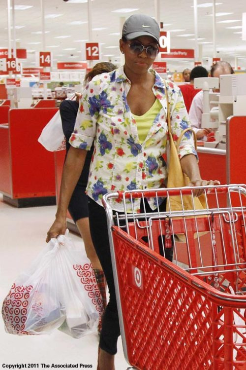 paid2see:  Attention shoppers! First Lady Michelle Obama has said in the past she likes to go shopping incognito. AP photographer Charles Dharapak found her doing just that in a suburban Washington retailer today wearing sunglasses and a ball cap. Charlie made this frame with his Canon 1D Mark IV and a 24-105mm lens. His exposure was 1/200 @4.5 rated 2500iso.