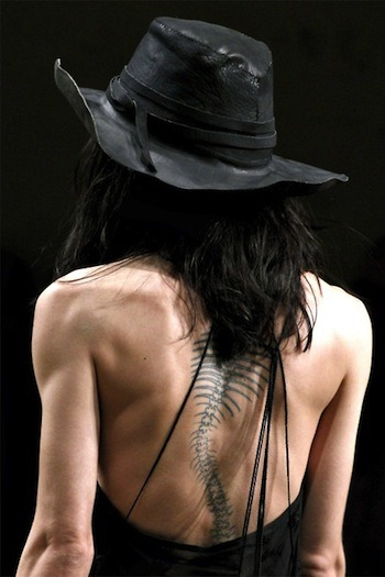 orderlyfashion:  Photo from Ann Demeulemeester PFW SS12 Such a cool tattoo!