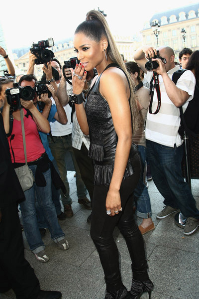 Ciara whipped the paparazzi into a frenzy while attending the Barbara Bui show during Paris Fashion Week on Thursday. The R&B dominatrix looked sexy in black leather pants and pointy-toed heels with a long ombre ponytail as she posed for photographers outside.