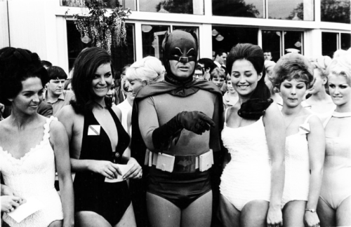 vintagegal:  Adam West as Batman, in England with beauty contestants 1960's
