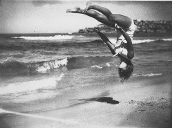 Peggy Bacon in mid-air backflip, Bondi Beach, Sydney, 6/2/1937 / by Ted Hood by State Library of New South Wales collection on Flickr.