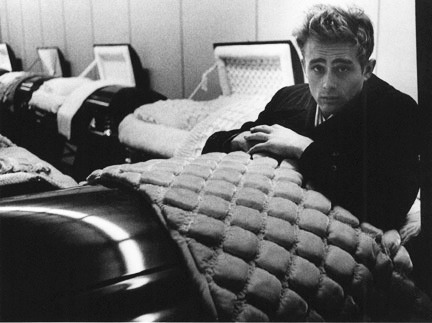 "theossuary:  This is probably my favorite all-time picture of James Dean, for obvious reasons. I also found this on Wikipedia:  While completing Giant, and to promote Rebel Without a Cause, Dean filmed a short interview with actor Gig Young for an episode of Warner Bros. Presents in which Dean, instead of saying the popular phrase ""The life you save may be your own"" instead ad-libbed ""The life you might save might be mine."" [sic] Dean's sudden death prompted the studio to re-film the section, and the piece was never aired—though in the past several sources have referred to the footage, mistakenly identifying it as a public service announcement. (The segment can, however, be viewed on both the 2001 VHS and 2005 DVD editions of Rebel Without a Cause.)  Seriously, people? Be careful out there on the roads, because that is some dangerous and serious shit. People are getting more device-distracted by the hour out there, and I've had many close calls just in the last few months. I don't care how comfortable the interior of your SUV is and how much cool shit you can go beep-boop-boop on while you drive; just please fucking pay attention.  obitoftheday:  Obit of the Day (Historical): James Dean (1955) On this date fifty-six years ago, James Dean died from injuries received in a car accident in his Porsche 550 Spyder. He was only 24 years old. Dean, who spent most of his childhood on his aunt and uncle's farm in Fair Mount, Indiana, moved to California after high school and attended UCLA. He dropped out in 1951 to pursue an acting career. Good move. Dean landed three starring roles in three films: East of Eden (1955), Rebel Without a Cause (1955), and Giant (1956). Besides a few uncredited roles, that's Dean's entire filmography. However, he shone is all three roles and was the first actor to receive a posthumous Academy Award nomination, Best Actor for East of Eden. He received another Best Actor nod for Giant. (Image copyright Dennis Stock from his collection, James Dean: A Memorial Portfolio, 1955/1979. A majority of the photos, including this macabre image, were taken in Fairmount, Indiana shortly before his death. The image is courtesy of The Museum of Contemporary Photography, which is located in Chicago.)"