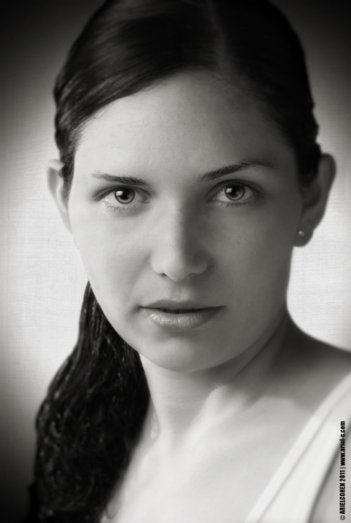 A classic black and white portrait of a female model.   This shot was taken using my Canon EOS 7D and a Canon EF 24-70mm f/2.8L USM at 70mm, f/11, 1/200 and 100 ISO. I used a diffused off-camera flash (580EX II - triggered wirelessly) for the main light-source and a silver-reflector as a fill-light to light the shadows in her face. Here's the set-up…   The next step was working with an image-proccessing software to convert to a black-and-white and emphasis certain parts in the face to maximize the expression (such as the eyes). One of things that I like about this photo is the way it composed - Even that it's cropped, the result is pleasing. Best regards, Ariel Cohen :)