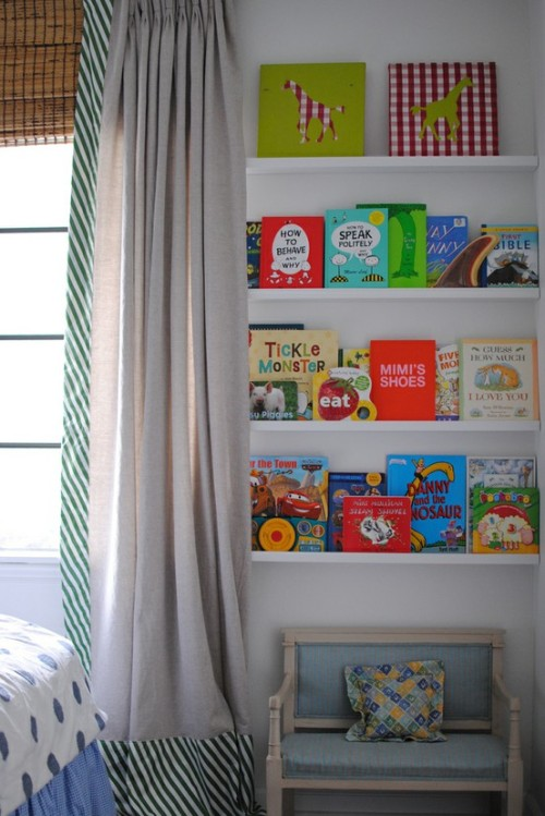 The shelves are too high to be functional for a kid. Lower might *actually* encourage reading via easy access.  I won't get on a rant about decor being functional, not just attractive in magazine spreads…