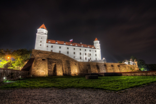 Bratislava Castle Slovakia Monumental castle known from the beginning of 10th century, built on former Slavonian fortification from 9th century from Great Moravian Empireabove Danube river. Latest reconstruction is from 1956-1968. One of the city signatures. Location: N 48.142276, E 17.100043 Architecture styles seen in castle: romanesque, gothic, renaissance, baroque The castle stands on a hill where the earliest occupation dates back to the Neolithic period (5th millennium BC). The Castle was first time mentioned in Salzburg annals in 907 AD. Current appearance was built in 15th century AD (1427). The palace wing was built between 1431-34. Next reconstruction happened between 1552 - 1639 lead by Italian architects. The castle became coronation headquarters during the Tartar incursions from the east. The last big reconstruction was based on works of french, italian and austrian architects - J. N. Jadot, L. N. Pacassi and J. B. Martinelli in 1750-1760. In 1811 the castle was ruined by big fire and for 140 years remained damaged. The reconstruction started in 1953 restored its original appearance.   Taken by this guy :)