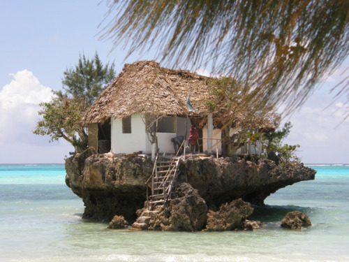 The Rock Restaurant is a tiny seafood restaurant, off the island of Zanzibar, that is literally perched on a rock in the middle of the Indian Ocean. (via Architizer)