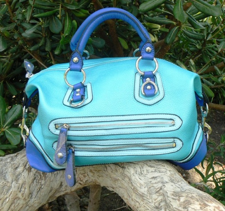 This stunning blue handbag is fun, modern, and beautiful all the way down to the last detail. It features a blue satin lining, lots of pockets for storage, cell phone, etc, and a cross body strap. Be the most unique fashionista and own the most unique bag!If it looks this cool in the photos, imagine how fabulous it is in person. And it also comes in pink! Check it out via @ShopCopious !