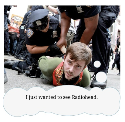 Radiohead at Occupy Wall Street was a hoax. So that sucks. However, what's not a hoax is that whoever comes up with the best thought bubble for this photo is going to win a sharp BuzzFeed hoodie.