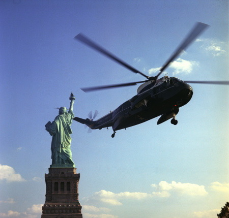 Marine One, the Presidential helicopter, flying near the Statue of Liberty for LBJ's signing of the Immigration Act of 1965. C670-3-WH65