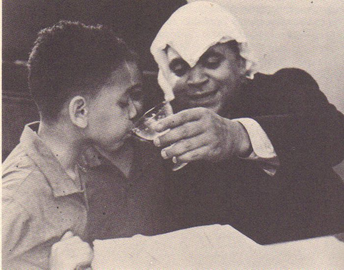 "vintageblack2:  Fats Waller giving his son, Maurice a ""little taste"". Reminds me of my dad when my mother's back was turned..lol  Did your dad do this too?  Happy Father's Day"