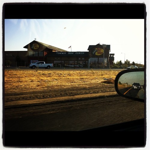 #bassproshop in #Manteca, #califonia. #freeway #fishing #boats #hunting #iPhone #building #bass #pro #shops #car #sidemirror #dead #grass #sunset  (Taken with instagram)