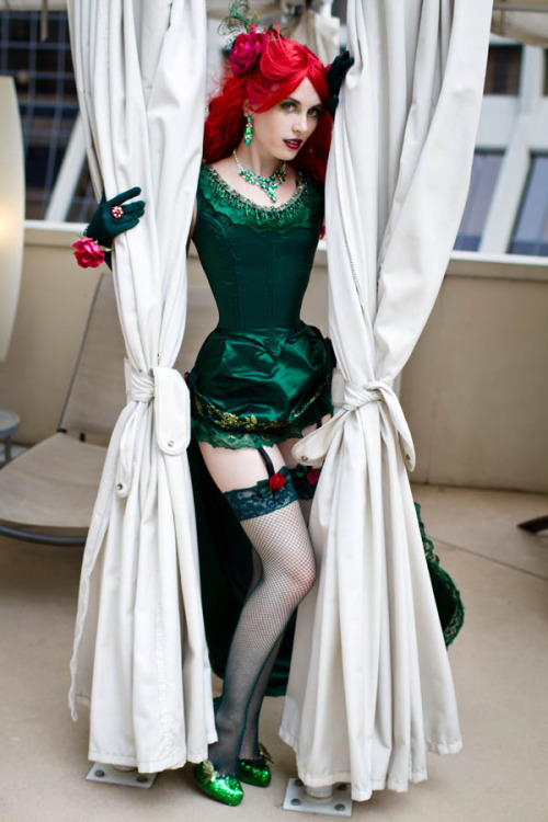 contextisfortheweak:  Burlesque Poison Ivy by ~arktoi (Claire Max, whose commentary is below)  My original design Burlesque Poison Ivy outfit, worn at DragonCon 2011. I  entered this in the Comic Book Babes contest, but sadly I didn't win  anything. I made the entire costume, with the exception of the  gloves and stockings, which were ordered from welovecolors.com. My shoes  were plain pumps purchased on ebay for $10, which I then covered with  green glitter and sealed with clear acrylic sealant. This was my first  time making a real steel-boned corset, and I'm super happy with how it  turned out! It's not visible here, but the skirt has a long  train trimmed in emerald green lace, and the border of the entire skirt  is hand-stencilled with a flower and vine pattern, which I then  embellished with individual swarovski crystals, also by hand. Lots of  tedious work. The jewelry I happened to find last minute at a korean  gift shop XDPhoto by Anna Fischer, who is absolutely amazing.     ……wow. That is gorgeous.