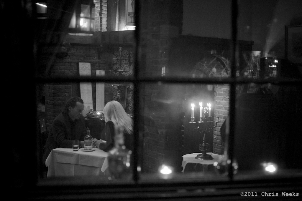 Amsterdam, The Netherlands:  July, 2011.  Quiet Tuesday night for a nice dinner after midnight.  I always like moments like these.  Wish the M9 would do a bit better at high ISO's, though.  Then again, if I had been shooting film I'd have been at 400 or so.  Thank God for nice fast Leica glass.  Leica M9.  35 'lux.  Aperture » Silver Efex Pro 2.