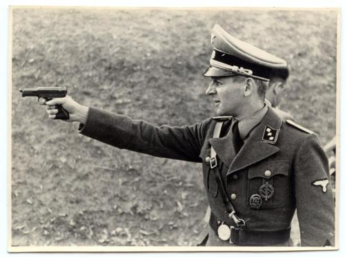 dergutekamerad:  German officer shooting with his Mauser pistol