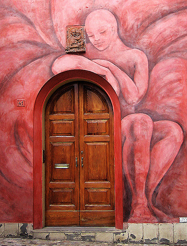 Colorful mural and door in Bologna, Italy (by Firenzesca)