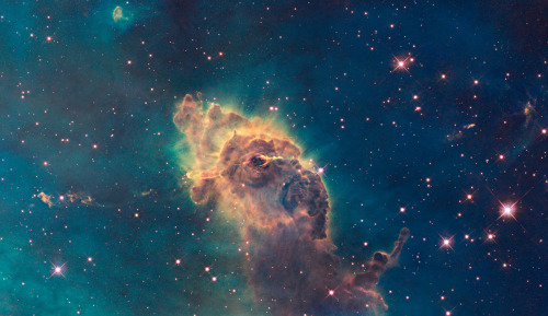 cwnl:  Carina Pillar and Jets  Distance: 7,500 light-years away from Earth  This cosmic pillar of gas and dust is nearly 2 light-years wide. The structure lies within one of our galaxy's largest star forming regions, the Carina Nebula, shining in southern skies. The pillar's convoluted outlines are shaped by the winds and radiation of Carina's young, hot, massive stars. But the interior of the cosmic pillar itself is home to stars in the process of formation.  Credit: NASA, ESA, and the Hubble SM4 ERO Team