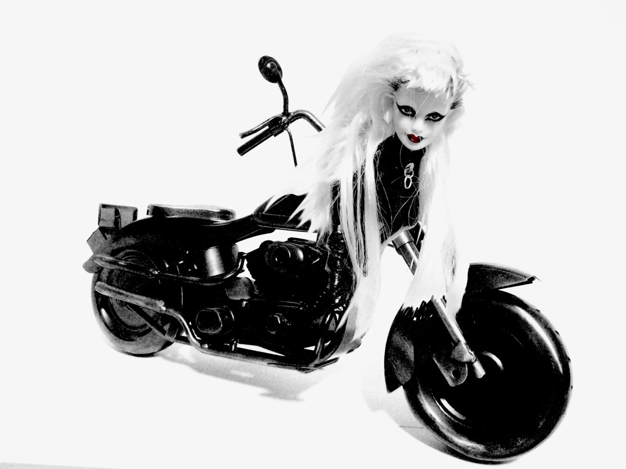 rebelrebelblackandwhite:  BORN THIS WAY Motorcycle Barbie doll. Created by Christian Cimoroni.   Fucking amazing.