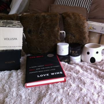"Gifties from Devin! Voluspa candles galore, Coyote fur blanket, and ""Love Wins"" by Rob Bell. So happy!"