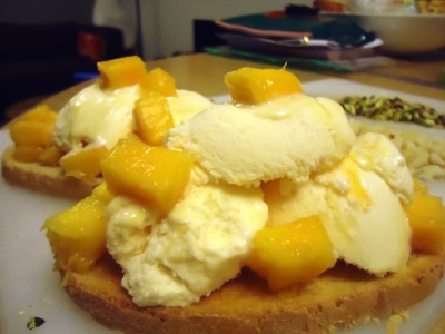 Mango delight  A midnight crispy toasted bruschetta topped with fine mango yogurt and diced fresh mangoes. Life is GOOD.