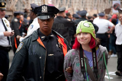 "stay-human:  occupytheplanet:  A close up photo of the 13 year old  ""Invader Zim Girl"" arrested yesterday during the #OccupyWallStreet protest on the Brooklyn Bridge. [via: @blogdiva]  They arrested a 13 year old girl… that is all you need to know about how ""free, democratic countries"" of such as the U.S. deal with peaceful protestors.  WHAT THE SHIT?"