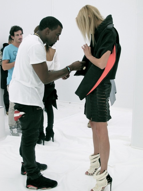 bureaubetak:  Kanye West & Anja Rubik.  Kanye West SS12 Fashion Show, Paris Fashion Week. Photographed by Anna Bernadó.