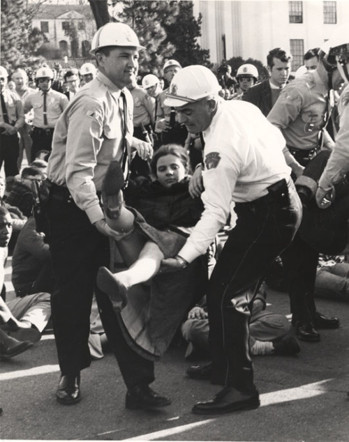 White female marcher being carried away by Montgomery police, March 1965 The Selma to Montgomery Marches were organized in March of 1965 by the Dallas County (Alabama) Voters League and the Student Nonviolent Coordinating Committee to protest discrimination against black voters.  At that time, less than 1% of voting age blacks in Dallas County were registered to vote because of intimidation and a literacy test. It took three tries for the protesters to successfully make their way from Selma to Montgomery.  On March 7th (Bloody Sunday) protesters made it only six blocks before they were attacked by police with billy clubs and tear gas.  On March 9th, Martin Luther King, Jr. led a symbolic march to Edmund Pettus Bridge where they had been turned back two days early.  On March 16th, Federal District Court Judge Frank Johnson ruled in favor of the march and the state of Alabama was forced to allow the protest. On March 21st, thousands assembled in Selma for the march to Montgomery.  Most were black, although white, Asian and Latino protesters also took part.  Walking 12 miles a day, they made it to Montgomery on March 25th and an enlarged protest of 25,000 people headed for the State Capitol Building.    On March 15th, President Lyndon B. Johnson submitted the Voting Rights Act of 1965 to Congress saying:  Even if we pass this bill, the battle will not be over. What happened in Selma is part of a far larger movement which reaches into every section and state of America. It is the effort of American Negroes to secure for themselves the full blessings of American life. Their cause must be our cause, too, because it is not just Negroes but really it is all of us who must overcome the crippling legacy of bigotry and injustice. And we shall overcome.  Today Edmund Pettrus Bridge is part of the National Park Service's Historic Places of the Civil Rights Movement.