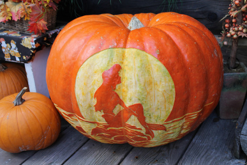 We know it's a little late for pumpkin pics, but just look at this! How cool is this carving?!