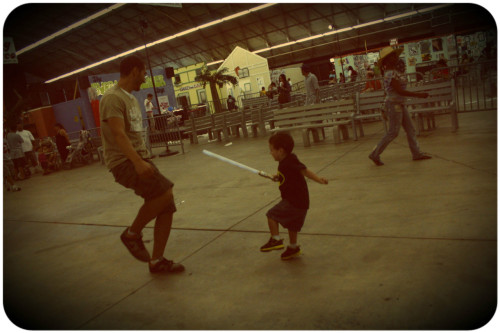 father + son + lightsaber battle > picture 2