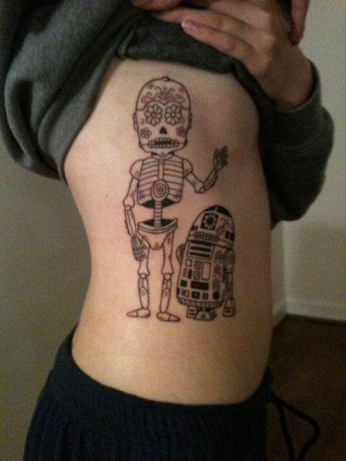 fuckyeahtattoos:  Day of the Dead R2-D2 and C3PO. I love Star wars so much and R2 and C3 are beyond my favorite characters.Done by Greg Howell at Jack Brown's Tattoos in Fredericksburg, VA
