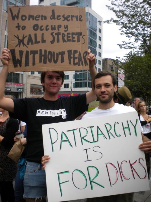 nerdy-nicole:  ddeennaaa:  Corey and the awesome sign we made (right), posing with his favorite protester. I think these were the two best signs of the whole day.  ALL THE STREETS!