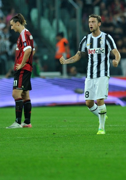 Juventus' midfielder Claudio Marchisio (R) celebrates after scoring as AC Milan's Swedish forward Zlatan Ibrahimovic looks down during Italian serie A football match Juventus vs Ac Milan, at Juventus stadium in Turin on October 2, 2011.GETTY IMAGES