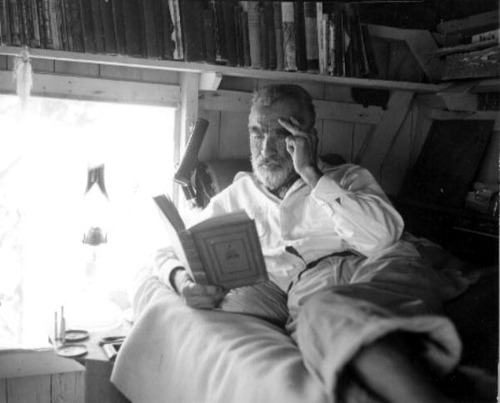 Old hermit Roy Ozmer reading a book at his house: Pelican Key, Florida by State Library and Archives of Florida on Flickr.