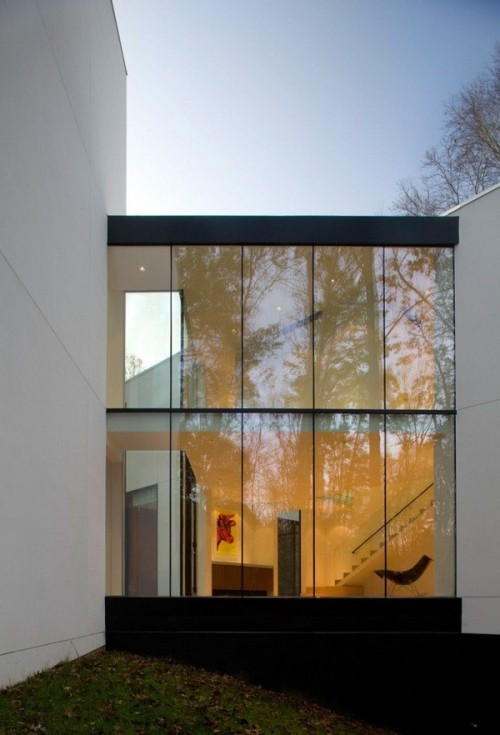 The Graticule House  designed by studio David Jameson Architect located near the estuary of a river in Great Falls, Virginia, USA