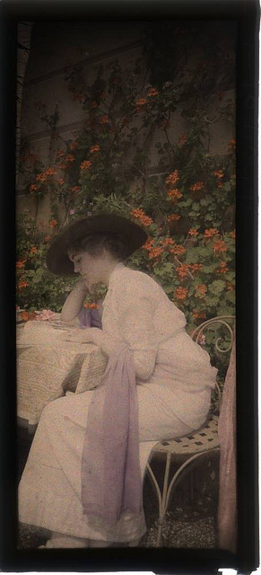 Woman reading in garden by George Eastman House on Flickr.