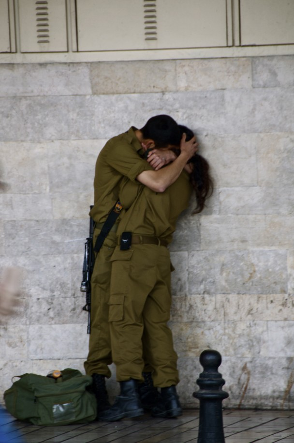 Photographer: Randy Pressman - (2011) August Israeli soldiers in a quick and intimate embrace. Editorial: National Geographic aMUSEme…Debutante