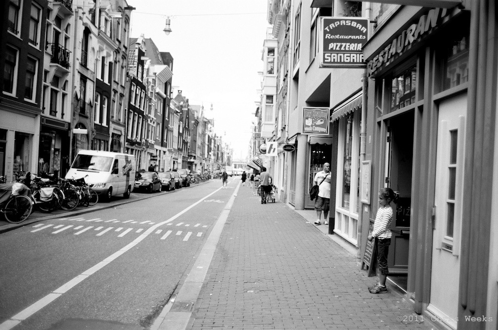 Amsterdam, Holland:  July, 2011.   Waiting patiently.  Leica MP.  35 'lux.  Lab scan »> Aperture.  (Tri-X during the night and Agfa APX 25 with ND during the day but not exact)