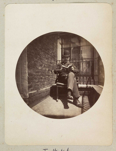 Seated man reading a book by National Media Museum on Flickr.