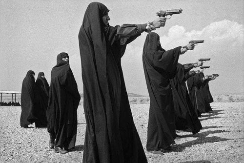 Veiled women practice shooting on the outskirts of the city, Teheran, Iran, 1986 Jean Gaumy