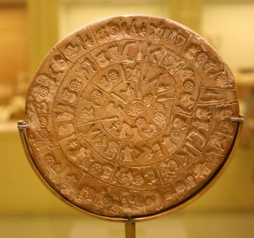 fuckyeahvalhalla:  The Phaistos Disc (also spelled Phaistos Disk, Phaestos Disc) is a disk of fired clay from the Minoan palace of Phaistos on the Greek island of Crete, possibly dating to the middle or late Minoan Bronze Age (2nd millennium BC). It is about 15 cm (5.9 in) in diameter and covered on both sides with a spiral of stamped symbols. Its purpose and meaning, and even its original geographical place of manufacture, remain disputed, making it one of the most famous mysteries of archaeology. This unique object is now on display at the archaeological museum of Heraklion.