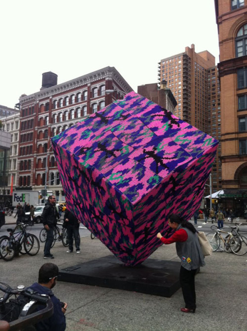 "hyperallergic:  Astor Place Cube Latest to Get a Crocheted Cozy Is the anything Olek won't crochet? Is anyone or thing safe from her maniacal need to cover things up? Another question we're pondering, do we like Bernard Rosenthal's ""Alamo"" (1967) better this way? Hmmm … READ MORE (photo courtesy Alex Sarkesian)"