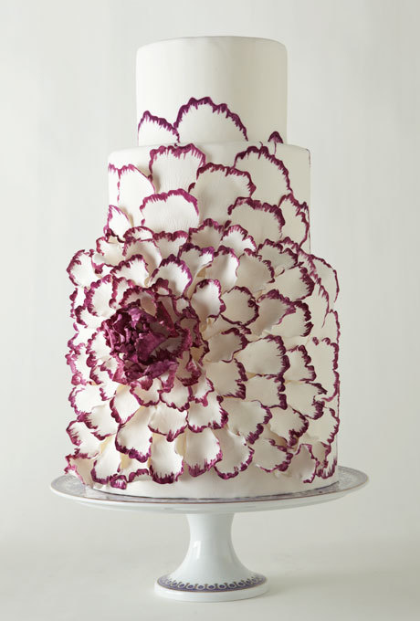 I normally hate floral cake decorations, but this one looked so cool. It looks like a pop-up. Apparently, it was inspired by a Yumi Katsura gown that had a huge peony on it. Not bad. Fondant cake with hand-painted sugar-dough petals, $20 per slice, Sacred Sweets, Greenport, NY; stand, Versace for Rosenthal