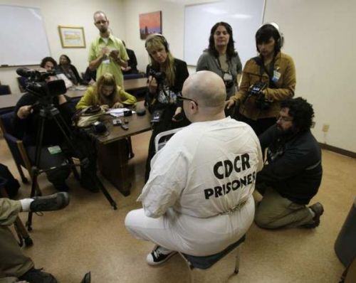 barrio2barrio:  latimes:  Prison hunger strikers now number 12,000, advocates say:  Advocates for California prison inmates conducting a hunger strike said the number of participants has swelled to 12,000, making it possibly the largest prison strike in recent U.S. history.  Photo: Inmate Timothy Kelly at Pelican Bay State Prison, where inmates waged a hunger strike in July to protest alleged mistreatment. Credit: Rich Pedroncelli / Associated Press   Hopefully those #OccupyWallStreet people will stand up for my homies locked down dealing with oppression on the daily. This isn't just a passing fad for them  ^ cosign.