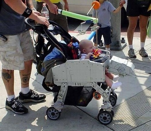 Parenting Win: AT-AT Imperial Stroller This kid is living the dream and he's too young to even realize it. I've never even owned a car that was a fraction as cool as this little human being's stroller. (via Geeks Are Sexy)