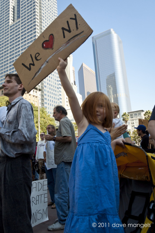occupyla:  A young girl holds up a sign at the Occupy LA protest on October 1, 2011 in Los Angeles, CA.