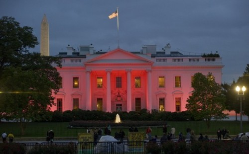 chacat:  The White House in Washington is bathed in pink light Monday, Oct. 3, 2011, in recognition of October as Breast Cancer Awareness month. -Getty Images