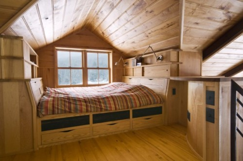 bed in a wooden nook (by Birdseye Design)