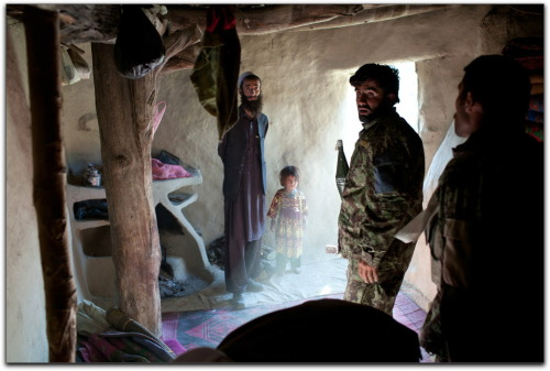 futurejournalismproject:  Ten Years in Afghanistan New York Times photographer Tyler Hicks has — among other assignments — has spent ten years photographing the Afghan war. On the Times' Lens blog is a slide show of his work about which Hicks writes:  I do it because I am photographer. I am a photographer working for a newspaper, and to ignore this American war, or any other war that we are involved in, would be an unfulfilling way for me to work. It's an important issue to document: America is involved in more wars at one time that it has been in its history, and I feel it is not just a job but an obligation to document it, and not only for each day's readers of the newspaper but for the people who will reflect on these conflicts 10 years, 20 years or 100 years from now.  Image: Afghan soldiers search a home in the Chabaran Valley, September 2011 — Tyler Hicks