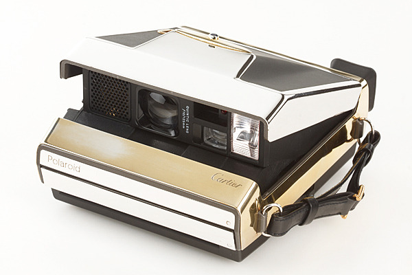 Only 4 golden Cartier Polaroid cameras were made in 1988. Each are 22 carat with 3 shades of gold.  It may just be the shiniest camera we've ever seen. The Cartier Gold Polaroid at the WestLicht Photographica Auction via mijonju